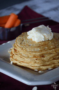 Carrot cake pancakes with chocolate chips and cream cheese frosting