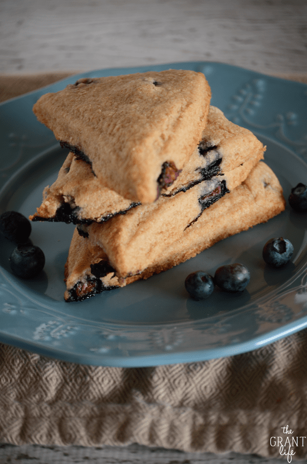 Healthified bluebery scone recipe!  A few simple swaps make these super flaky blueberry scones better for you then before!