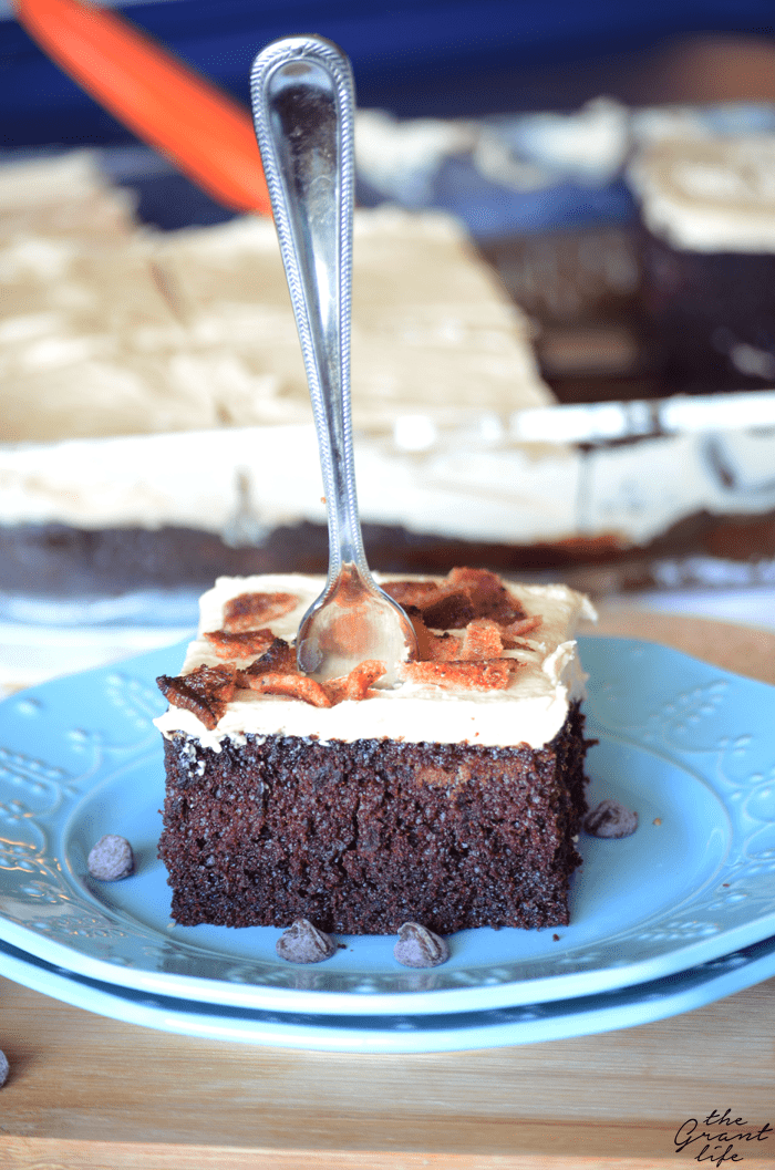 Chocolate cake with peanut butter frosting and bacon on top