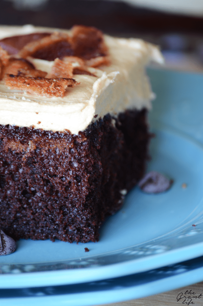 Delicious chocolate cake with peanut butter frosting and crispy bacon on top