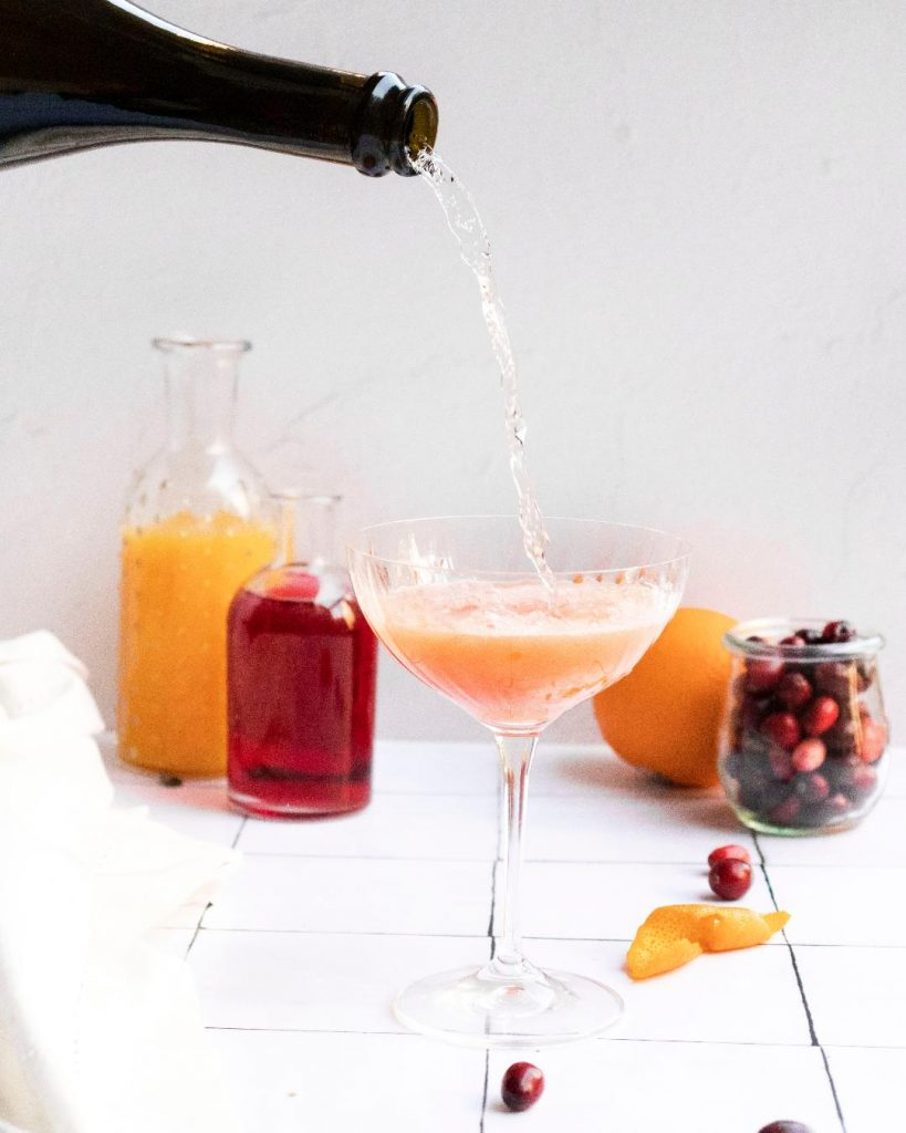 cranberry orange mimosa pour shot
