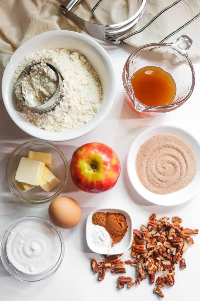 bowls filled with ingredients for apple cider scones